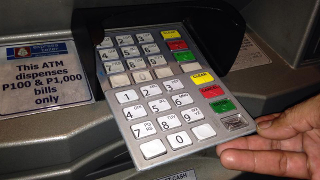Check for overlay or fake keypad to protect your credit cards from skimmers